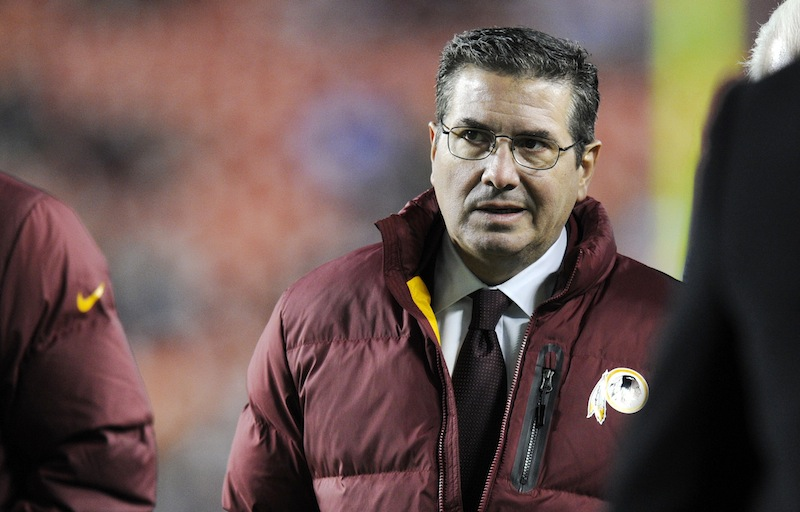 In this December 2013 file photo, Washington Redskins owner Dan Snyder walks off the field before an NFL football game. Snyder said on April 22, 2014, it's time for people to address