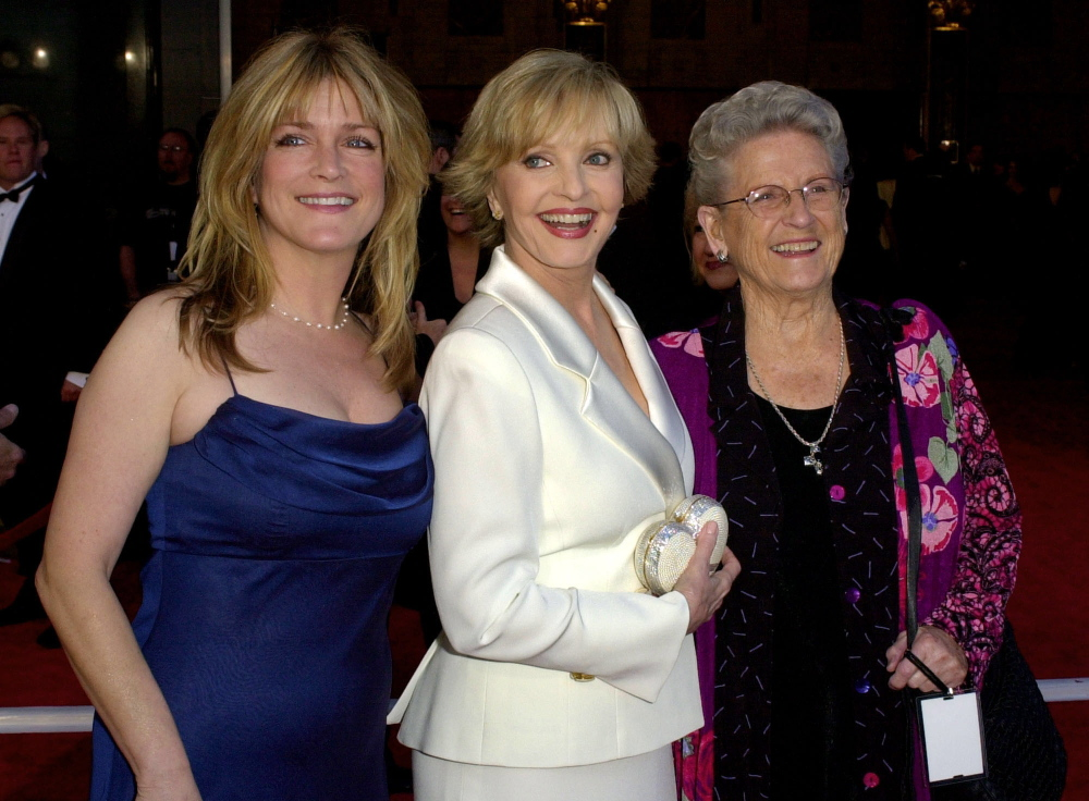 """Florence Henderson, center, is flanked by fellow cast members of """"The Brady Bunch"""" television show Susan Olsen, left, and Ann B. Davis as they arrive to ABC's 50th Anniversary Celebration Sunday, March 16, 2003, at the Pantages theater in Los Angeles."""