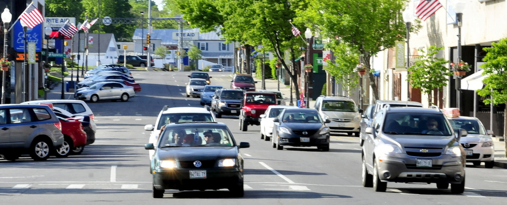 TRAFFIC: Traffic moves through downtown Waterville on the one-way Main Street on Sunday. City officials are exploring ideas to return Main and Front streets to two-way traffic to ease congestion, slow traffic down and encourage shoppers to patronize downtown businesses.