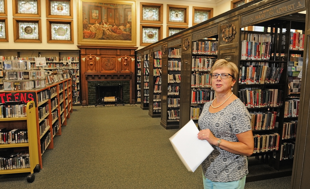 Director: Betsy Pohl, library director, leads a tour of Lithgow Library on Tuesday in Augusta.