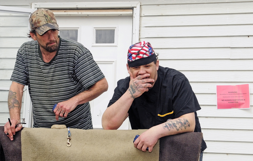 FIXING UP: Tyson Joseph Goldstein, left, and Brett Hollowell Sr., say they plan to stay at Meadowbrook Trailer Park now that improvements are in the works.
