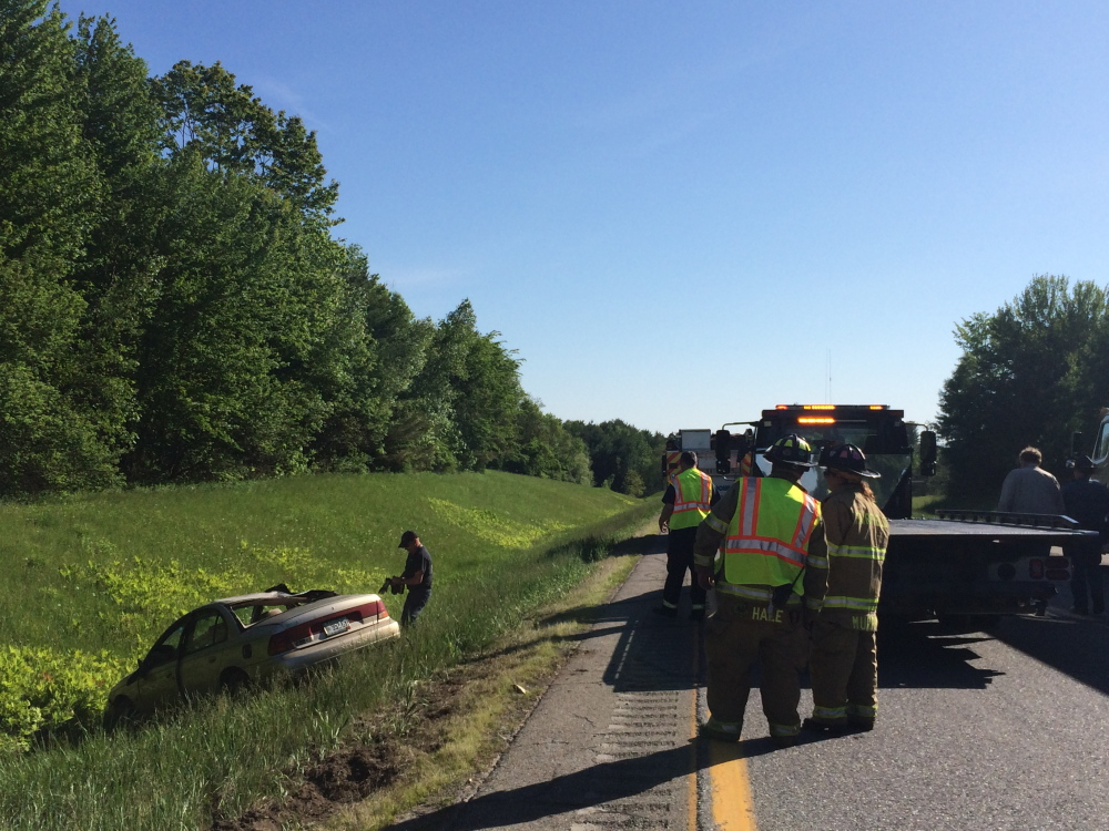 Accident: Recovery crews prepare to remove a Dodge Stratus that ran off Interstate 95 southbound and rolled over near Benton Tuesday afternoon at about 5 p.m. The driver of the car, a Detroit man, was not injured.