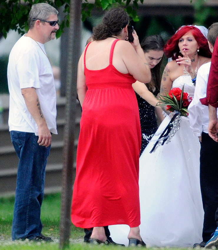 Theresa Rice-Goodrich, right, gets prepped for her wedding Sunday July 27, 2014 with Fred Horne Sr., left, at Fort Halifax Park in Winslow. Horne was arrested for giving the bride away at the ceremony that was held in the gazebo at the Park. He was charged with two counts of violating conditions of release. (Photo by Andy Molloy/Staff Photographer)