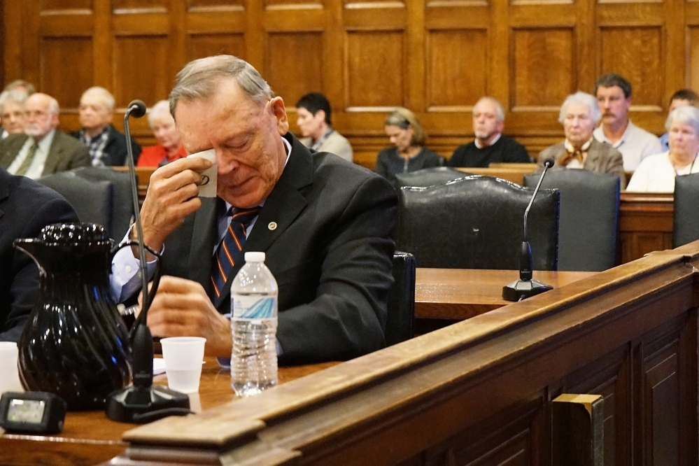 Former Maine State Police Chief Andrew Demers Jr. wipes tears from his eyes as a former police colleague testifies in the Cumberland County Courthouse on Tuesday, about how Demers' actions, sexually assaulting a 4-year-old child, have tarnished the reputation of the police force.