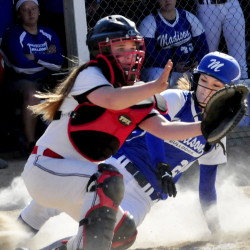 Madison's Kayla Bess beats the throw to home as Hall-Dale's Emma Begin, left, covers during a game in Madison on Thursday. Madison won 9-5.