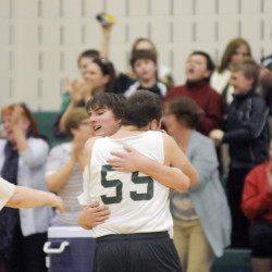 Sebastian Coston, right, hugs Winthrop unified teammate Sage Thomas after Thomas drained a 3-pointer that drove fans and teammates to their feet during a quarterfinal game against Messalonskee last season in Winthrop.