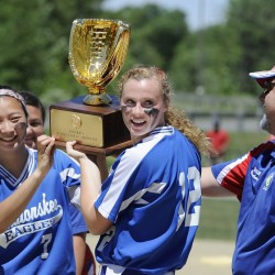 Messalonskee softball coach Leo Bouchard, right, watches Mollyan Killingbeck, left, and Kristy Prelgovisk hold up the Class A state championship trophy after the Eagles edged Scarborough 1-0 in the 2015 Class A state title game. Bouchard recently resigned, citing the physical demands of the job.