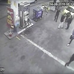 In this Sunday, Aug. 14, 2016 frame from surveillance video released by Brazil Police, swimmers from the United States Olympic team appear with Ryan Lochte, right, at a gas station during the 2016 Summer Olympics in Rio de Janeiro, Brazil. A top Brazil police official said the swimmers damaged property at the gas station.