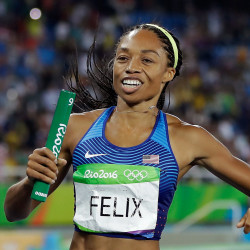 United States' Allyson Felix celebrates after winning the gold medal in the women's 4x400-meter relay final in Rio de Janeiro, Brazil, on Saturday.