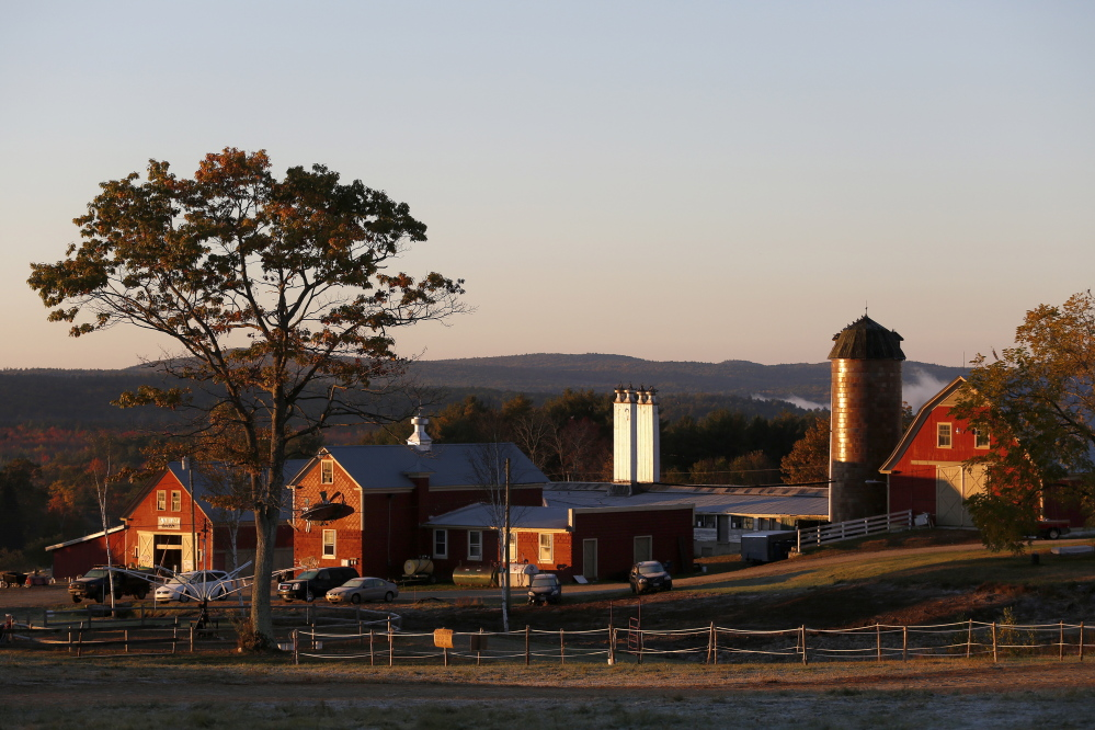 The sun breaks over Harvest Hill Farms in Mechanic Falls on Route 126 on Oct. 12, 2014, the morning after a hayride crash that is now at the center of several criminal charges. Harvest Hill Farms, the farm's mechanic and the hayride driver have all been charged in the crash, which killed Oakland teenager Cassidy Charette and injured more than 20 others.