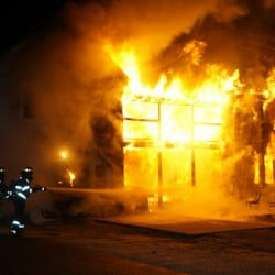 An apartment building at 54 Beal St. in Norway is engulfed in flames Monday night.  Photo courtesy of WCSH