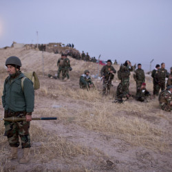 Kurdish peshmerga forces gather prior to opening up a front against the Islamic State in Nawaran, some 13 miles northeast of Mosul, Iraq, on Thursday. Peshmerga are launching an offensive to take the villages on the Nawaran mountain, pulling closer to Mosul.