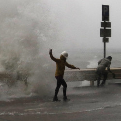 Waves caused by Typhoon Haima crash into Hong Kong. The storm headed toward southern China on Friday after hitting the Philippines.