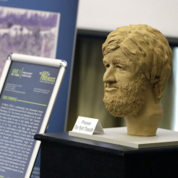 A clay bust and details surrounding an unidentified victim in a Florida cold case file is shown during the the Art of Forensics conference at the University of South Florida in Tampa.