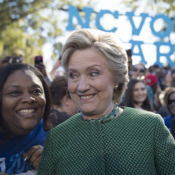 Democratic presidential candidate Hillary Clinton greets supporters during a campaign event at St. Augustine's University on Sunday in Raleigh, N.C. Clinton's strong poll numbers are allowing her to buoy downballot Democratic campaigns. Associated Press/Mary Altaffe