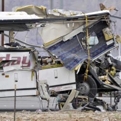 The front end of a tour bus was severely damaged when it crashed into the back of a semi-truck on Interstate 10 just north of the desert resort town of Palm Springs, in Desert Hot Springs, Calif., on Sunday.
