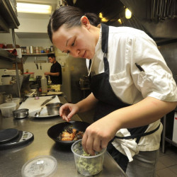 Award-winning  chef Cara Stadler says eliminating tips will allow her two restaurants to offer better pay to cooks and other back-of-house employees.