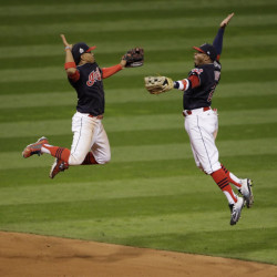 Cleveland Indians Francisco Lindor and Rajai Davis celebrate after winning Game 1 of the World Series on Tuesday night in Cleveland. The Indians won 6-0 to take a 1-0 lead in the series.
