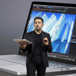 "Panos Panay, Microsoft's vice president of devices, displays an updated Surface Book at a media event Wednesday in New York. ""We want ... to help everyone create,"" he said."
