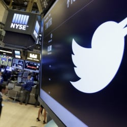 The Twitter symbol appears above a trading post on the floor of the New York Stock Exchange in July.