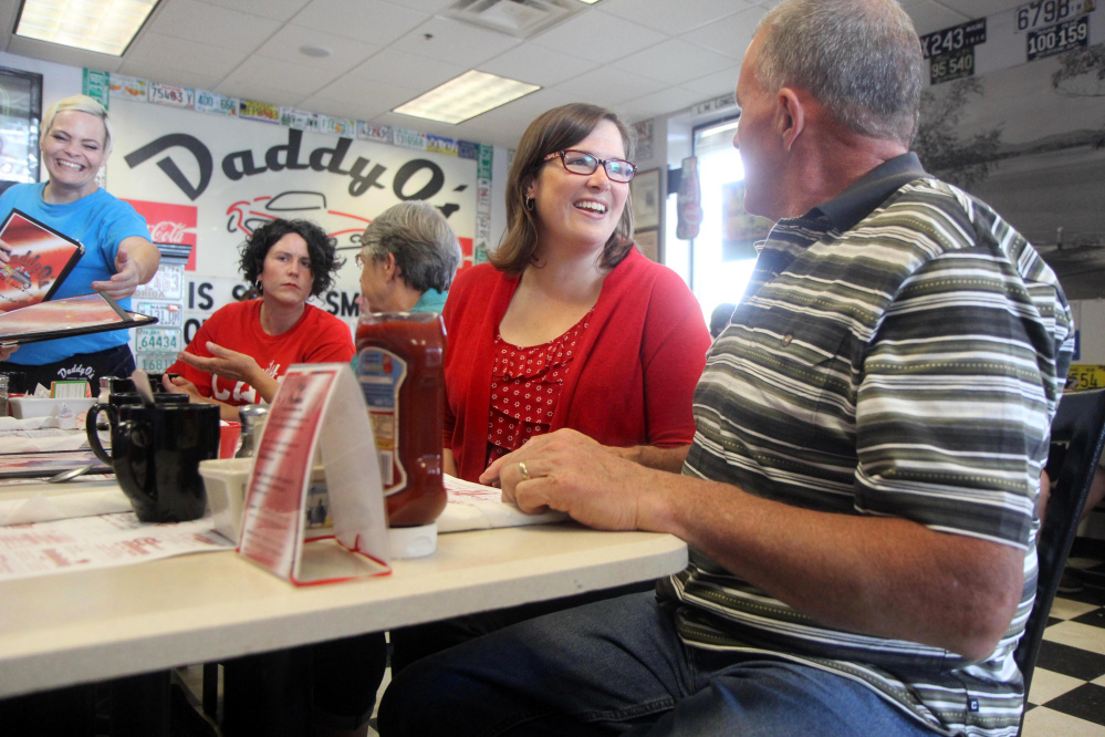 Democrat Emily Cain chats with Mike Twitchell of Norway while having breakfast Aug. 26 at Daddy O's Diner on Route 26 in Oxford. Twitchell, a former Norway selectman, is a candidate in the House District 71 race.