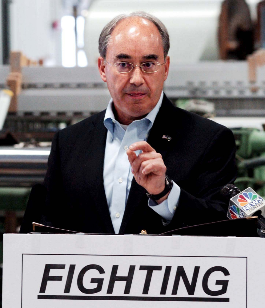 U.S Rep. Bruce Poliquin, R-2nd district, makes a point about fair trade at Auburn Manufacturing on Aug. 30.