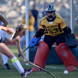 Mt. Blue Erika McArthur protects the cage as Skowhegan's Mariah Dunbar looks to score during a Kennebec Valley Athletic Conference Class A game Thursday in Farmington.