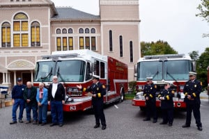 Monmouth Fire Department dedicated its entire fleet of four apparatus to two former and two current members of the Monmouth Fire Department on Oct. 2. All four dignitaries have a combined 209 years of service to the town of Monmouth. Standing in front of the two new engines that were recently placed into service this past summer, from left are Capt. Dan Niles (51 years), Capt. (ret.) Everett Palleschi (50 years), Chief (ret.) Paul Fox (56 years) and Chief (ret.) Laurence Folsom (52 years), Chief Dan Roy and Assistant Chiefs Ed Pollard, Pat Smith and Ken Palleschi.