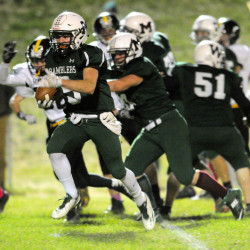 Winthrop/Monmouth's Nate Scott runs for a touchdown against Maranacook on Friday night at Maxwell Field in Winthrop.