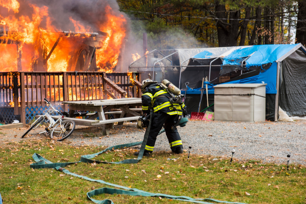 Farmington firefighters battle a mobile home blaze Tuesday morning on Whittier Road.