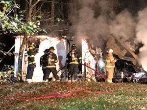 A mobile home was destroyed by fire on Route 133 in Winthrop early Thursday morning, and police later charged the homeowner with arson.