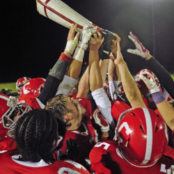 Members of the Cony High School football team celebrate with the boot trophy Oct. 23, 2015, after defeating Gardiner, 40-0, at Alumni Field in Augusta. It marked the second consecutive shutout for the Rams in the series, which dates to 1892. The teams meet again Friday night at Hoch Field in Gardiner.