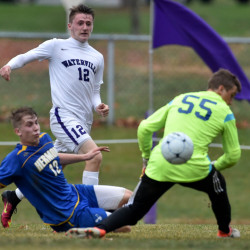 Waterville's Justin Wentworth (12) takes a shot on Hermon goalie Garrett Trask (55) as Zach Nash (12) tries to defend during a Class B North prelim game Friday at Webber Field in Waterville.