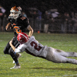 Gardiner's Collin Foye gets away from Cony defensive back Taylor Heath on Friday night in Gardiner.