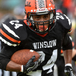 Winslow High School's Keanu Earle returns a fumble recovery for a touchdown in the second quarter against Waterville Senior High School on Saturday in Winslow.