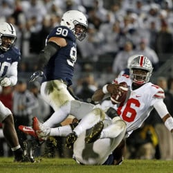 Ohio State quarterback J.T. Barrett (16) is sacked by Penn State's Jason Cabinda, behind, during the second half Saturday in State College, Pennsylvania. Penn State won 24-21.