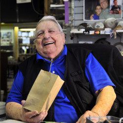"Levi ""Sonny"" Chavarie, who died Oct. 13 at age 91, laughs at something a customer said at his shop in Augusta in this 2015 file photo."