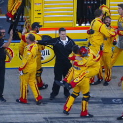 Joey Logano's crew members celebrate after winning the NASCAR Sprint Cup race Sunday at Talladega Superspeedway in Talladega, Alabama.