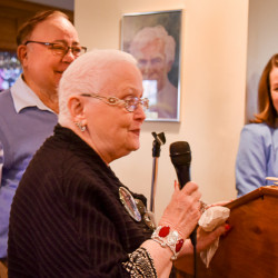 Charlie and Nancy Shuman, with microphone, of Winthrop, have been mainstays of the Kennebec Valley Humane Society and pitched in at the organization's annual auction Sunday at the Augusta Country Club in Manchester along with Executive Director Hillary Robert, right.