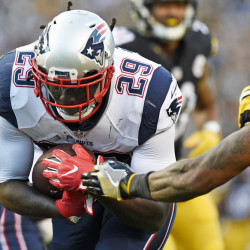 New England Patriots running back LeGarrette Blount scores during the first half against the Pittsburgh Steelers on Sunday in Pittsburgh.