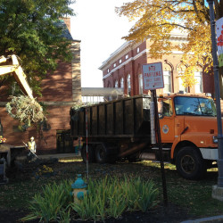 A giant blue spruce tree in Castonguay Square downtown is removed by city workers early Tuesday morning. Officials said about half of the tree was diseased.
