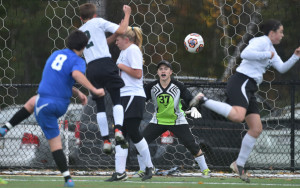 Islesboro junior Xan Howell (8) scores on Temple Academy goalie Tim Larsen during the first half of a Class D South quarterfinal game Tuesday afternoon at Thomas College.