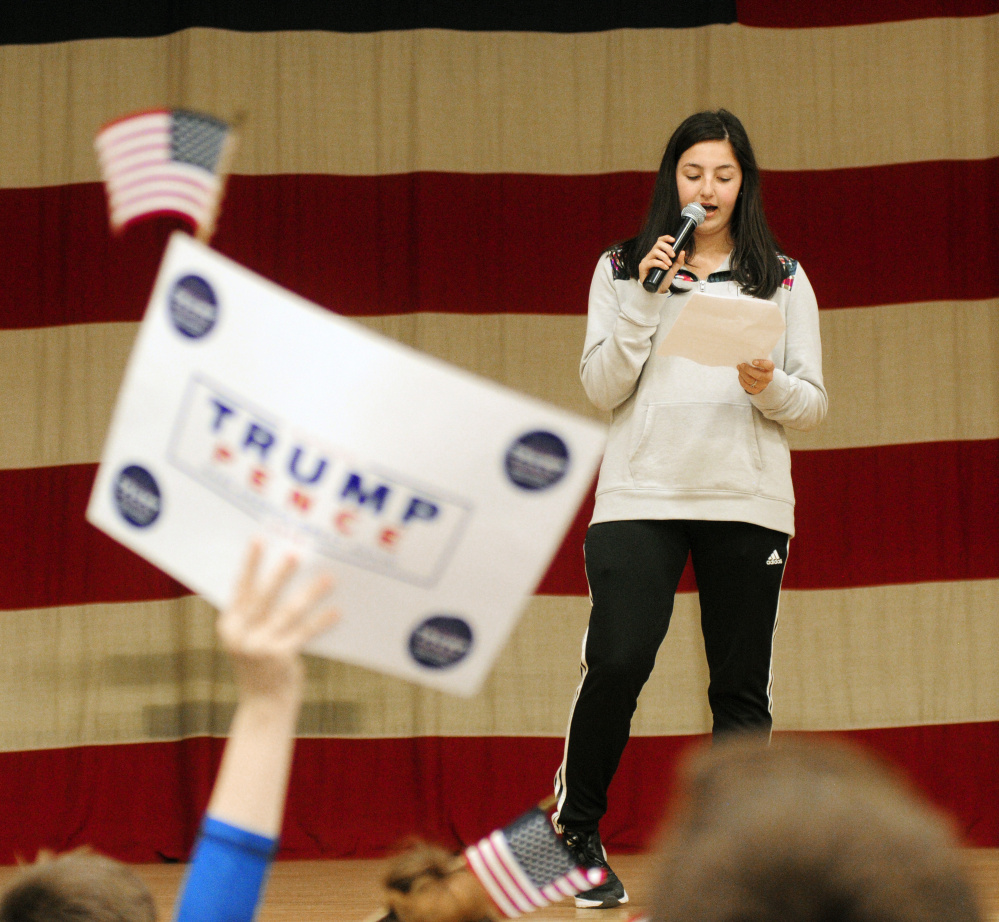 Cony student Brooklyn Merrill gives a stump speech Wednesday for Donald Trump during the secretary of state office's Student Mock Election event at the Augusta State Armory.