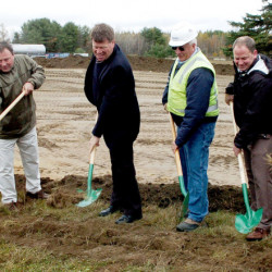 Supporters and officials, including Municipal Review Committee Executive Director Greg Lounder, third from left, and Fiberight CEO Craig Stuart-Paul, at right, take part in a groundbreaking ceremony Wednesday for the road leading to a planned Fiberight solid waste facility on Coldbrook Road in Hampden.