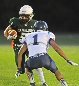Winthrop's Nate Scott, left, tries to get around Dirigo's Hunter White during a Campbell Conference Class D game earlier this season in Winthrop. By the time the Ramblers play a playoff game, they will have had two weeks off.