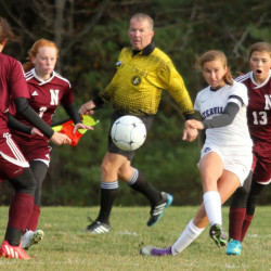 Waterville's Sophie Webb crosses the ball to Sofie Weston during the second half of a Class B North quarterfinal at Webber Field in Waterville on Wednesday. From left to right are Nokomis defenders Laura Freudenberger, Allysa Ellis and Sierra Robichaud.