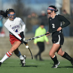 Messalonskee's Haley Bowman, left, battles for the ball with Skowhegan's Maliea Kelso during the Class A North title game Wednesday afternoon at Hampden Academy.