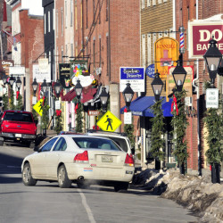This Jan. 5 photo shows a car leaving a parking spot along Water Street in Hallowell, where the state transportation department is planning a major road reconstruction project in 2018.