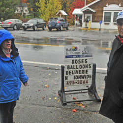 Jan Partridge, left, and Patrick Donahue talk Friday about a proposed crosswalk that will be located between Partridge's businesses, Balloons & Things and Pincurl Beauty Shop, and the Maine Lakes Resource Center Annex, where Donahue works, in Belgrade Lakes village.