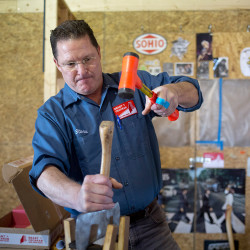 Steve Ferguson works on the handle of an ax he is restoring at his workshop in Portland. His company, Brant & Cochran, restores old axes and also sells axes that have been restored. He and his partners are meeting with blacksmiths and hoping to soon produce a Maine-made ax.